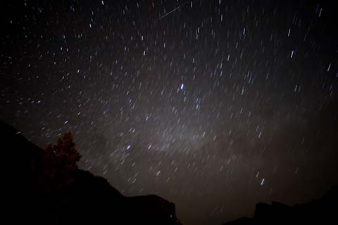 A starry night above the Yosemite Valley.  The small streak, top center, is the skip of a meteor on the atmosphere.
