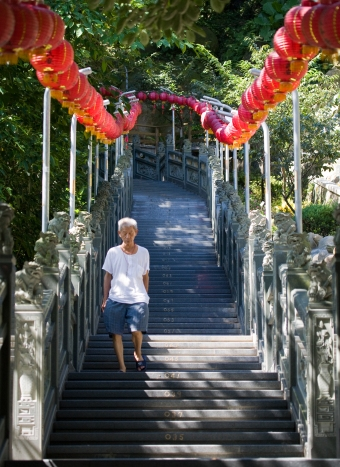 man walking down stairs at temple