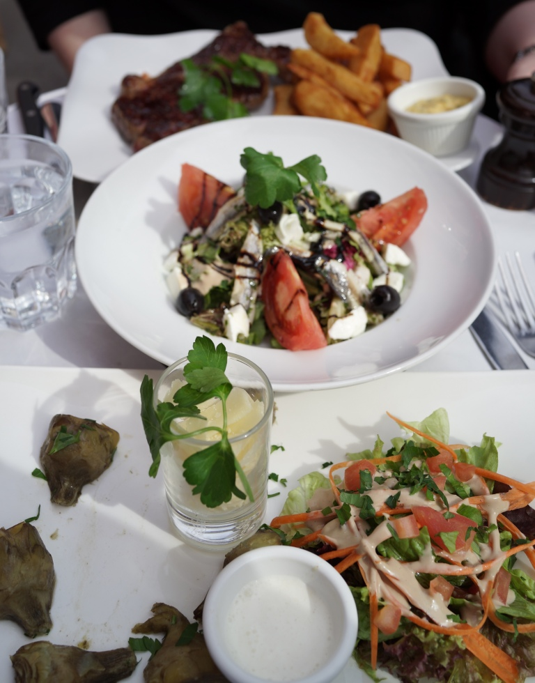 Our order: rib-eye steak with fries, baby artichokes with crème fresh and parmesan, and salad with anchovies, buffalo mozzarella and olives.