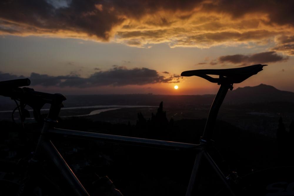 The bike has provided several beautiful sunset rides. Taipei, Taiwan.