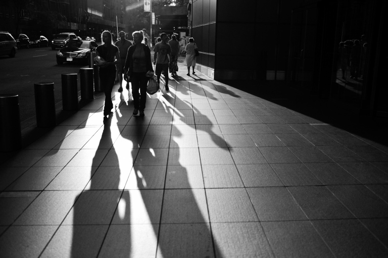 Backlit subjects on the streets of New York.