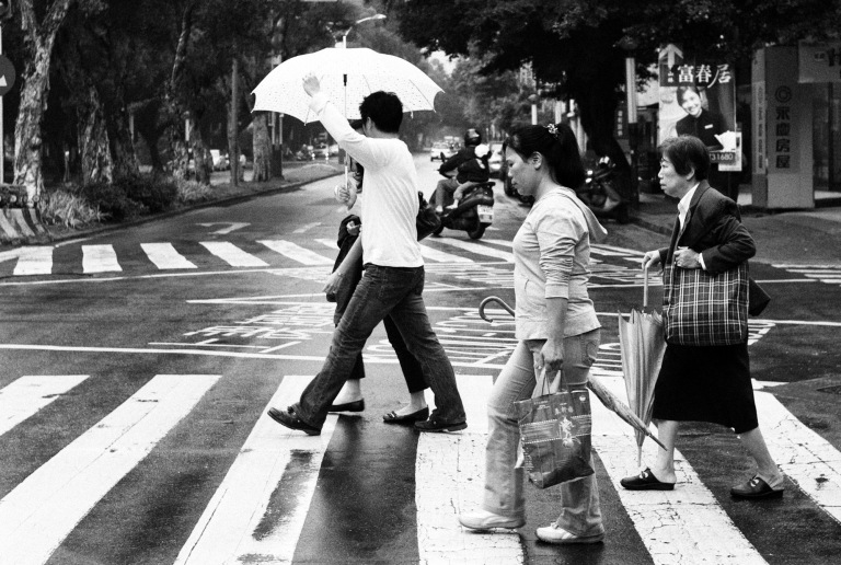 Crossing in the rain. Taipei, Taiwan