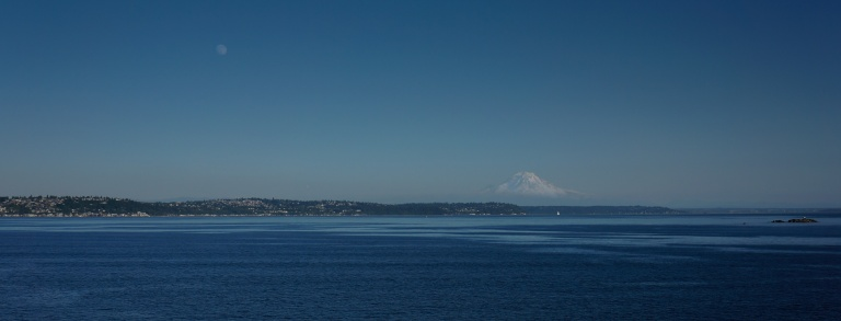 Taking a ferry always offers some unique views for the Puget Sound. If you look closely you can see this summer's Super Moon in the top left side of the frame. Mt. Rainier is still mostly snow-covered at this point in the summer.
