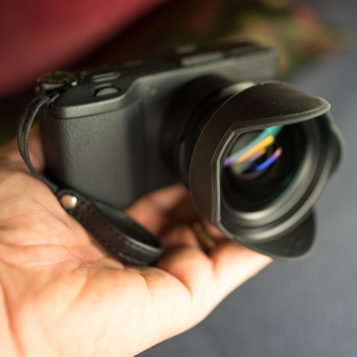 Front view of the GW-3 conversion lens attached to the Ricoh GR.