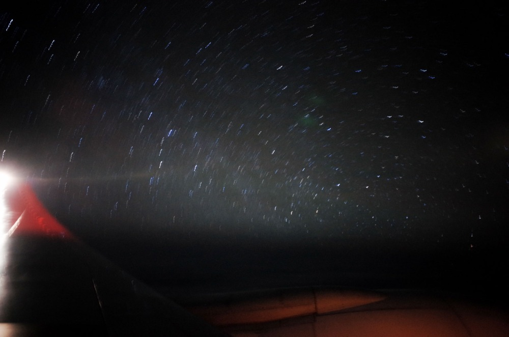 This one is a little different and far, far from technically decent. This is a one minute exposure from the window of a trans-Pacific flight. There is just the hint of star trails starting to appear.