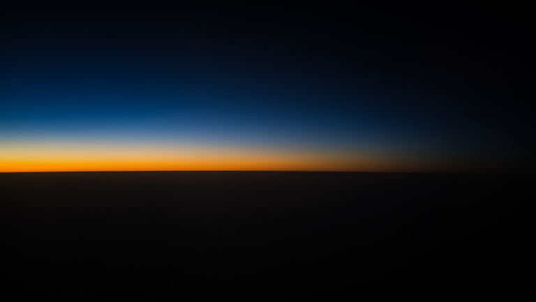 A pretty typical sunset/sunrise scene from cruising altitude.