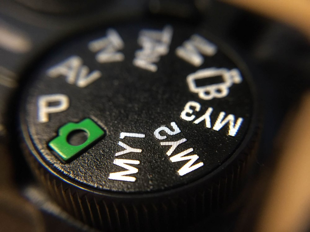 The dial of the Ricoh GR with the Bitplay SNAP! 6 case and macro lens.