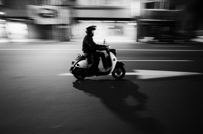 Scootin' down the road. (Ricoh GR w/ 21mm wide-angle adapter)