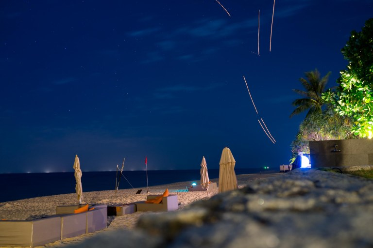 Some lanterns were being released into the night sky so I propped the camera up against some rocks for a long exposure. BONUS...I caught a shooting star skipping through the atmosphere in the upper right-hand side of the image. See crop below. (Sony RX1r)