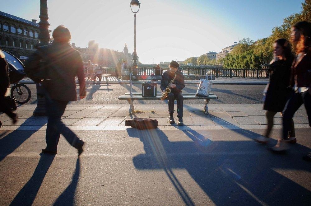 Saxophone man. Nice guy, talented and plays a beautiful 1954 modified saxophone. (Pont d'Arcole, Paris)