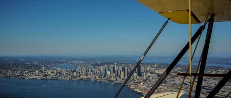 Peeking through the struts of a the 1937 Waco over downtown Seattle. (Sigma DP1 Quattro)