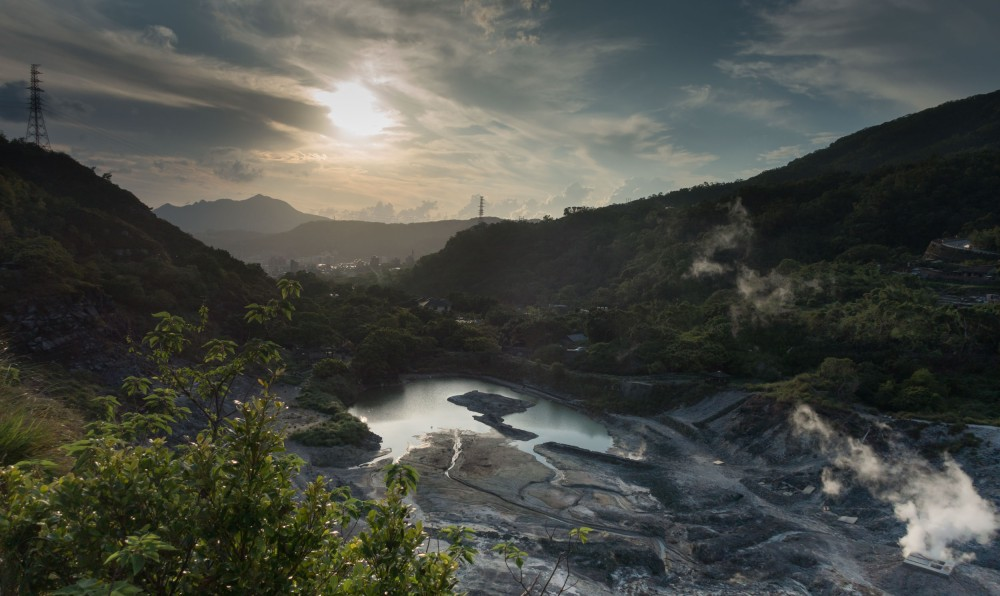 Shooting into the sun over a valley filled with hot spring activity near Beitou.