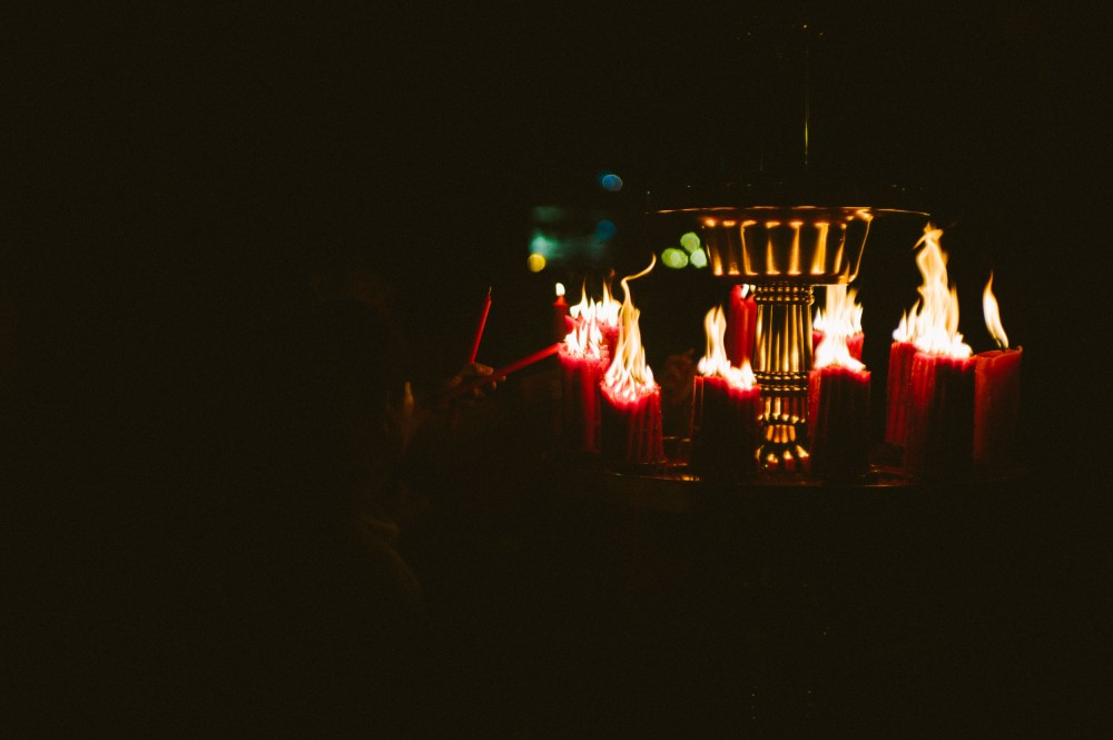 Bundles of candles at Longshan Temple. (Leica M9, Canon 50mm LTM, VSCO)